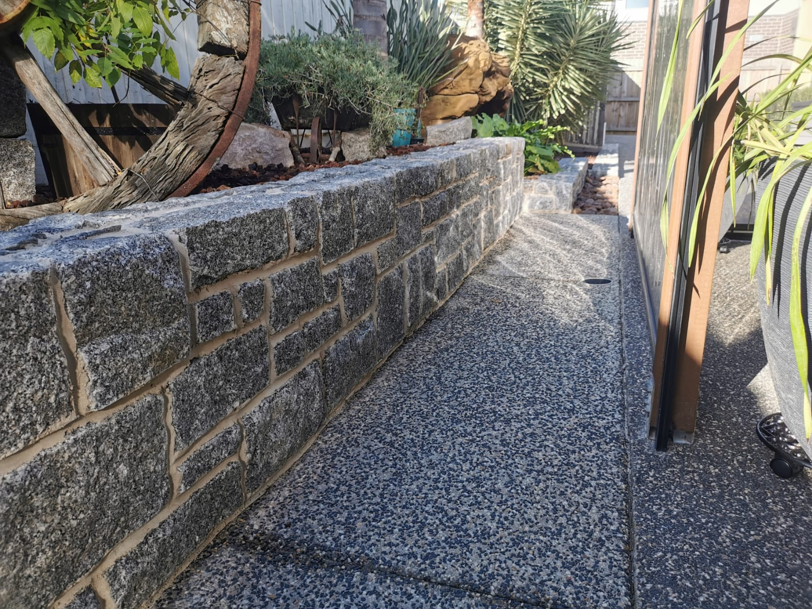 granite-garden-wall-cut-using-ashla-pattern Melbourne Stonemasons | Showcase | Call 0411 73 76 77